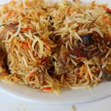 goat-pulao-(rice-cooked-with-goat-soup-and-berbs)